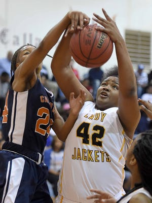 Starkville's Kelsey Jones (battles for a rebound against Callaway's Mary Boyd in the Region 3-6A championship game won by Starkville.