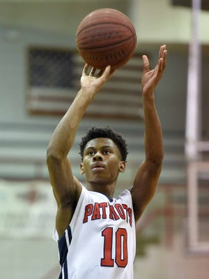 Forest Hill's Arthur Johnson shoots against Biloxi on Tuesday in the first round of the MHSAA state playoffs.