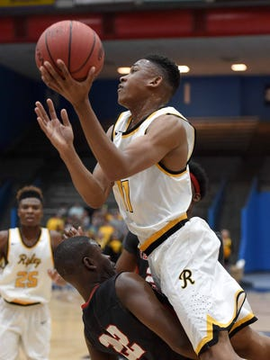 Ripley's Dewayne Cox (11) drives the baseline against Florence's Jaylon Johnson (22) on Wednesday, March 1, 2017, in the Class 4A quarterfinals of the MHSAA C Spire State Basketball Tournament at Jackson State University in Jackson, Miss.
