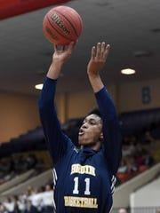 St. Joseph's Gabe Watson (11) shoots a three pointer