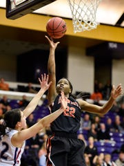 Ensworth's Dontavia Waggoner (22) shoots over Father