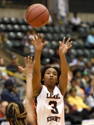 Leake County's Otashae Burrage (3) shoots a three pointer against Shaw on Monday, March 6, 2017, in the MHSAA C Spire State Basketball Tournament semifinals at the Mississippi Coliseum in Jackson, Miss.