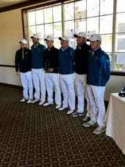 The UWF men's golf team gathers in clubhouse after