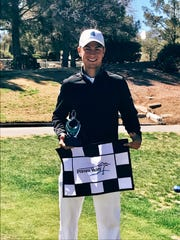 UWF's Chandler Blanchet with the 18th hole flag after