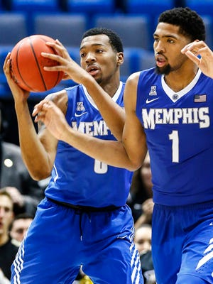 University of Memphis brothers K.J. Lawson (left) and Dedric Lawson (right) grab a rebound during action against Central Florida University at American Athletic Conference tournament game in Hartford, Conn.