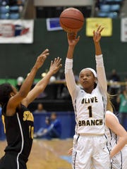 Olive Branch's Myah Taylor (1) shoots a three pointer