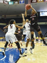 UL's Jaylyn Gordon (11) goes for a shot during the Ragin' Cajuns Sun Belt Tournament game against the Little Rock Trojans. Gordon led the team with 21 points.