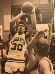 Troy Bond fires a jumper during a high school basketball game when he played at Lebanon.