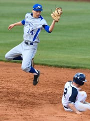 Reitz's Connor DeWeese is safe at second base as Memorial's Will Burger catches a high throw as Memorial plays Reitz at Bosse Field.