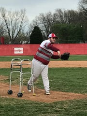Elijah Hardin throws out the ceremonial first pitch before Bosse's home opener.