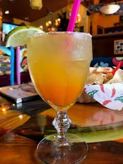 A small mango-flavored margarita on-the-rocks costs $7.50 at Mr. Tequila.