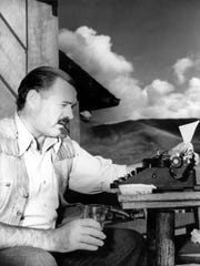 In this 1939 file photo, Ernest Hemingway is shown at his typewriter as he works at Sun Valley lodge, Idaho.