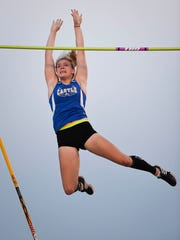 """Castle's Maddie Wilson clears 11' 9"""" to win the pole vault at the girls track sectional held at Mount Vernon High School Tuesday, May 16, 2017."""