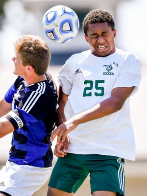 Greeneville's Devin Elyze-Vital (25) battles Page's Andrew Mekler (10) during the second half of the Class A-AA championship game at the Richard Siegel Soccer Complex in Murfreesboro, Tenn., Friday, May 26, 2017.