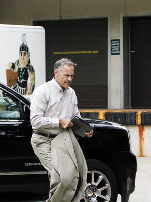 MSU Head Football Coach Mark Dantonio heads into the John A. Hannah Administration Building on Monday, June 5, 2017, for to speak to MSU's Board of Trustees, where he discussed the football program. The board had been meeting for a previously scheduled budget workshop.