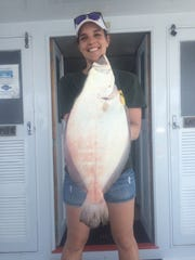 Sara Whiteford of Sacremento, California, caught this 8-pound, 8-ounce fluke on the Atlantic Star party boat on June 13.