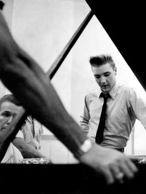 Elvis Presley, right, looks on during a recording session June 10, 1958, at the RCA recording studio in Nashville.