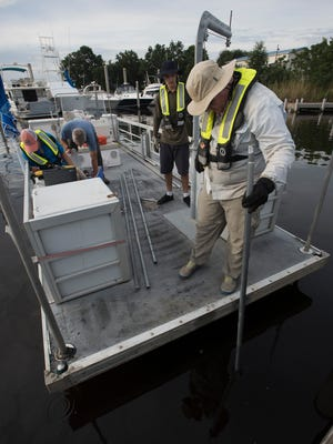 An Escambia County environmental team works on mapping the thickness and distribution of the soft sediments in the Bayou Chico, Tuesday, June 27, 2017. The data being collected by the survey team will be used to determine how much of the soft sediment is in the bayou and lead to a plan for remediation.