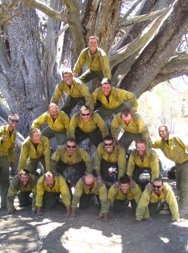 Christopher MacKenzie's camera captured the Granite Mountain Hotshots as they built a human pyramid in front of a juniper tree. Days later, they would be called to Yarnell.