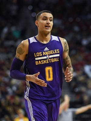Lakers forward Kyle Kuzma smiles after hitting a three-pointer late in the team's 2017 Summer League game against the Brooklyn Nets at the Thomas & Mack Center on July 15, 2017 in Las Vegas, Nevada. Los Angeles won 115-106.