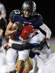 North Canyon's Solomon Enis (13) gets tackled by Arcadia's