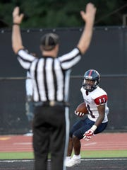 South Panola's Barry Flowers (11) scores a receiving