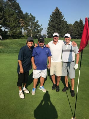 Aki Palmer, far right, aced the No. 9 hole at the Fort Collins Country Club on Monday to win an SUV. His playing partners from left were Tim Zahn,Todd Heenan and Ken Forzley.