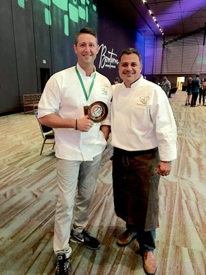 Chef Alex Belew of Murfreesboro holds the 'Fan's Favorite' Award from the 2017 Chefs Taste Challenge as he stands next to his sous chef, Nick Calias from The Colonnade Boston Hotel.