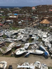 This Sept. 14, 2017 photo provided by Guillermo Houwer on Saturday, Sept. 16, shows some damaged boats at the Virgin Gorda Yacht Harbour in the aftermath of Hurricane Irma on Virgin Gorda, in the British Virgin Islands.