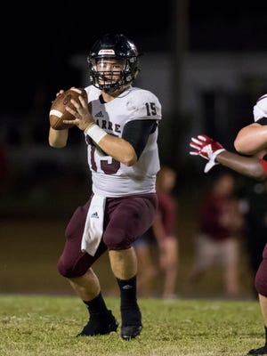 Navarre quarterback Sage Chambers drops back to pass last Friday against Pine Forest.
