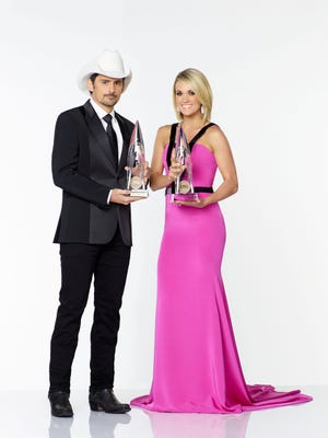 Brad Paisley and Carrie Underwood host the CMAs.