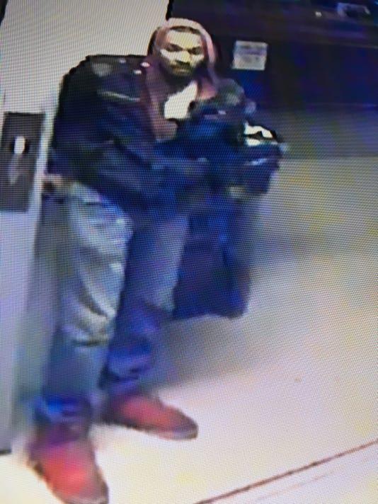 636444373983295383-Petrs-Gun-Shop-Suspect.JPG