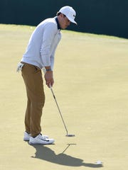 Defending champion Cody Gribble sinks his putt on the