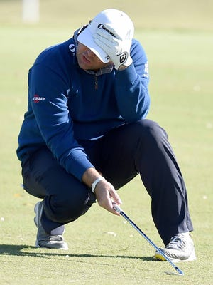 Jonathan Randolph reacts to the result of his fairway shot on the 18th hole on Saturday.