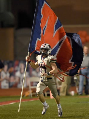 MRA's Jake Reeves (14) leads the Patriots onto the field to face PCS in a first round MAIS playoff game on Friday in Madison.