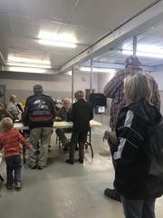 Voters line up cast their ballots for Virginia's governor, lieutenant governor and attorney general at the Wachapreague Fire House Tuesday afternoon, Nov. 7, 2017. With several hours left in the polls, nearly half of the precinct's 767 registered voters had already cast their ballots, said poll worker Cathey Bell.