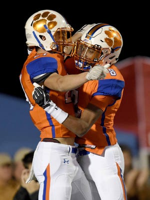 Madison Central's Hunter Blalock (left) celebrates his touchdown reception with Myles Hopson (8) during a MHSAA Class 6A first round playoff game on Friday, November 10, 2017, at Madison Central High School in Madison, Miss.