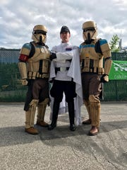 "From left, John Hooker, AJ Ferrano and Andrew Liptak appear in costume as part of the 501st Legion during ""Star Wars"" night at the Vermont Lake Monsters in summer 2017 in Burlington."