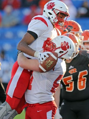 Beechwood running back James Davis celebrates with lineman Blake Soete after Davis' touchdown in the KHSAA Class A title game at Kroger Field at the University of Kentucky in Lexington. Beechwood defeated Raceland 41-0 to claim back-to-back Championships.