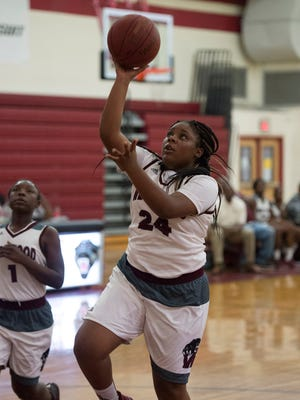Fort Pierce Westwood's Zaria Watkins takes advantage of a breakaway and puts a shot up against Port St. Lucie in the first half of their high school girls basketball game at Fort Pierce Westwood on Monday, Dec. 11, 2017, in Fort Pierce.