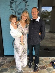 This undated photo provided by Cal Fire shows Fire Apparatus Engineer Cory Iverson, right, with his wife, Ashley, and their daughter Evie. Iverson, who worked for the department's San Diego Unit as a member of a fire strike team, died while fighting the Thomas Fire north of Fillmore.