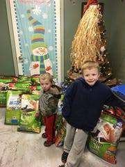 Jackson Dixon, 4, and Tyler Dixon, 7, helped their grandmother Noreen Dixon, of Albion, deliver her annual Christmas donations to PAWS Animal Shelter in Albion earlier this month