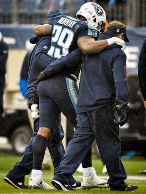 Titans running back DeMarco Murray (29) is helped off of the field after an injury during the second half against the Rams at Nissan Stadium in Nashville, Tenn., Sunday, Dec. 24, 2017.