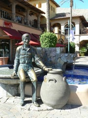 A bronze statue of Sonny Bono sits on Mercado Plaza in downtown Palm Springs.