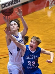 TCA's Vann Bryant catches a rebounded ball while defended by Chester County's Evan Allen on Thursday, Dec. 28, 2017, during TCA's 63-49 win over Chester County at the 2017 Hub Classic at Oman Arena in Jackson.