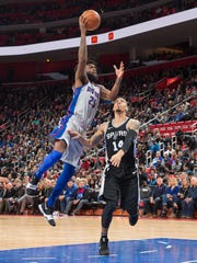 Pistons forward Reggie Bullock goes up for a lay up