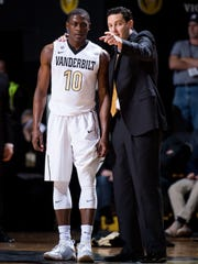 Vanderbilt coach Bryce Drew speaks with guard Maxwell Evans (10) during the first half against Alabama on Jan. 2.