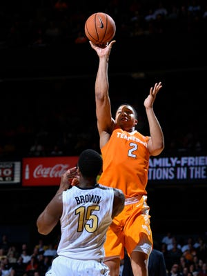 Tennessee forward Grant Williams (2) shoots over Vanderbilt forward Clevon Brown (15) during the second half at Memorial Gym in Nashville, Tenn., Tuesday, Jan. 9, 2018.