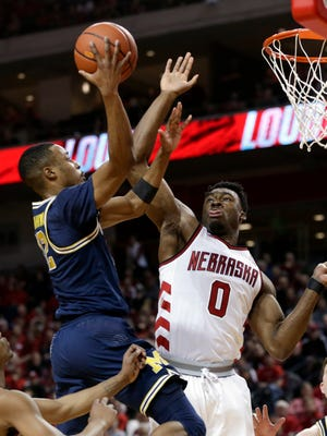 Nebraska's Duby Okeke goes up to block a shot by Michigan's Muhammad-Ali Abdur-Rahkman during the first half in Lincoln, Neb. on Thursday night.