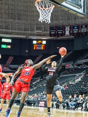 UL forward Simone Fields (32) goes for a layup as the